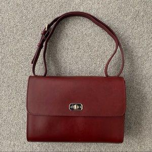 A.P.C.  Burgundy leather handbag.